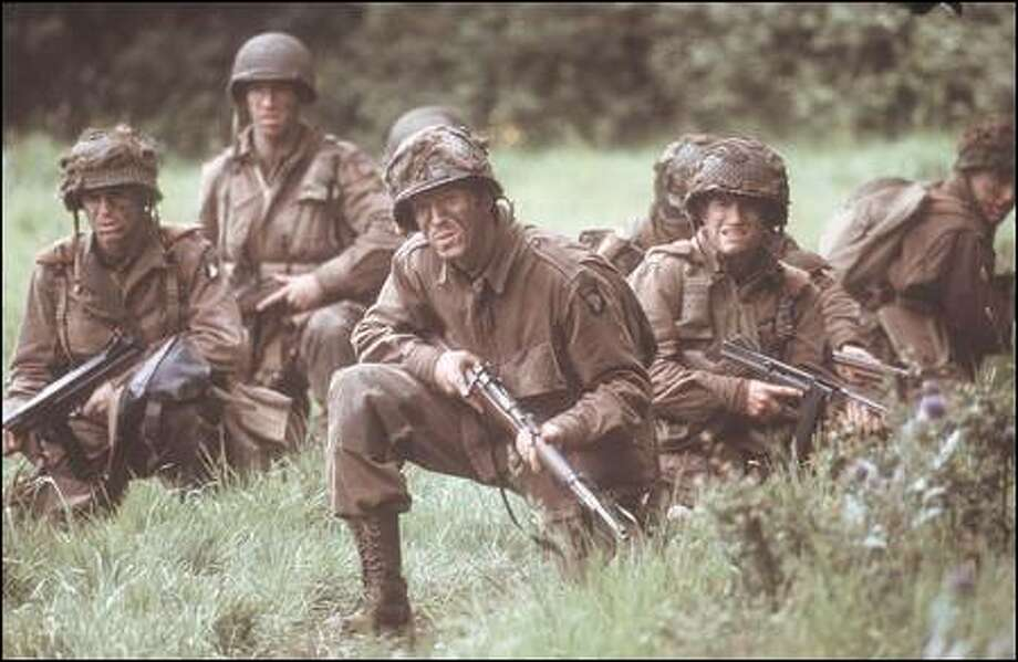 "HBO's ""Band of Brothers,"" with Damian Lewis and Frank John Hughes, in the foreground, realistically examines the human capacity for sacrifice and endurance."