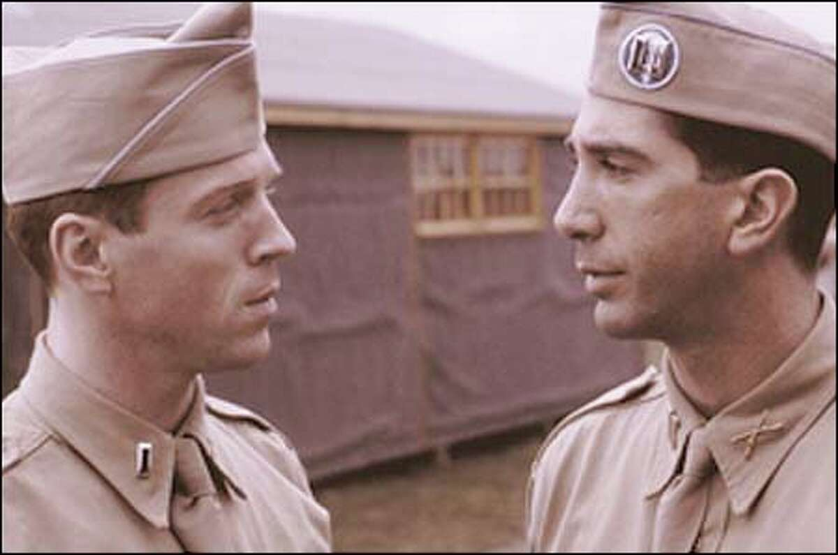 Often at odds, 2nd Lt. Dick Winters (Damian Lewis, left) and commanding officer 1st Lt. Herbert Sobel (David Schwimmer) share a moment.