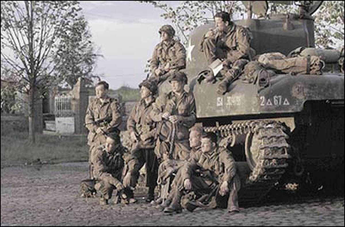 """""""Band of Brothers"""" cast includes, from left top, Philip Barrantini, Ross McCall; bottom, Donnie Wahlberg, Kirk Acevedo, Scott Grimes, Neal McDonough, Adam James and Frank John Hughes."""