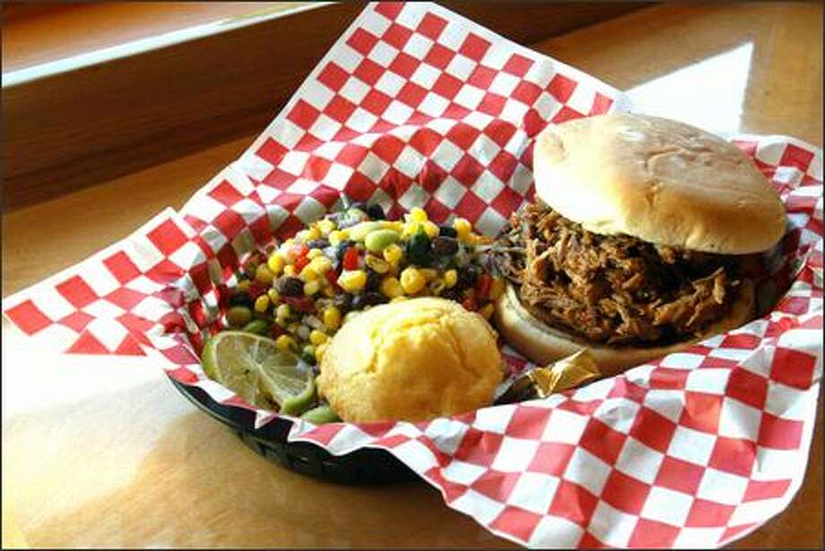 The pulled-pork sandwich comes with muffin, succotash and a dollop of Southern hospitality. Photo: Karen Ducey, Seattle Post-Intelligencer / Seattle Post-Intelligencer