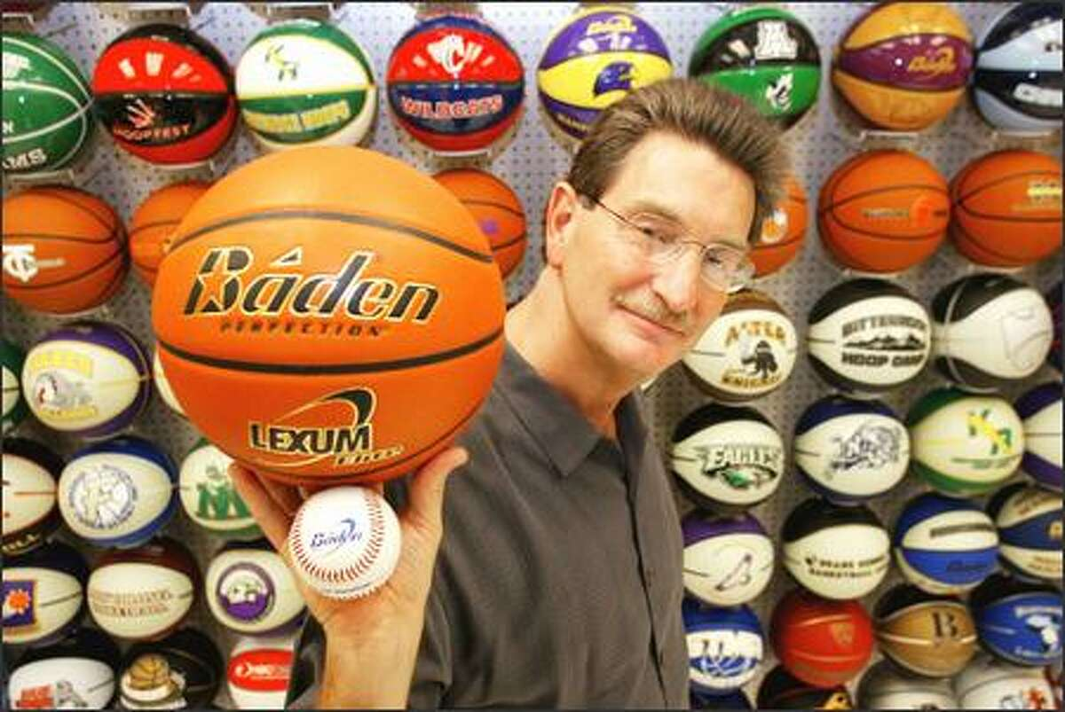 Michael Schindler of Baden Sports Inc. in Federal Way displays the company's two new products -- the Perfection Lexum Elite basketball and the All Weather PR-O baseball. The baseball, tested by the UW baseball team, is expected to reach stores in a few months.