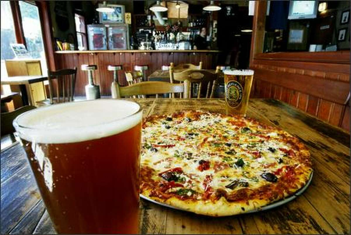 Fiddler's Inn offers hand-tossed pizzas, such as Zorba the Greek, and a fine lineup of local microbrews.