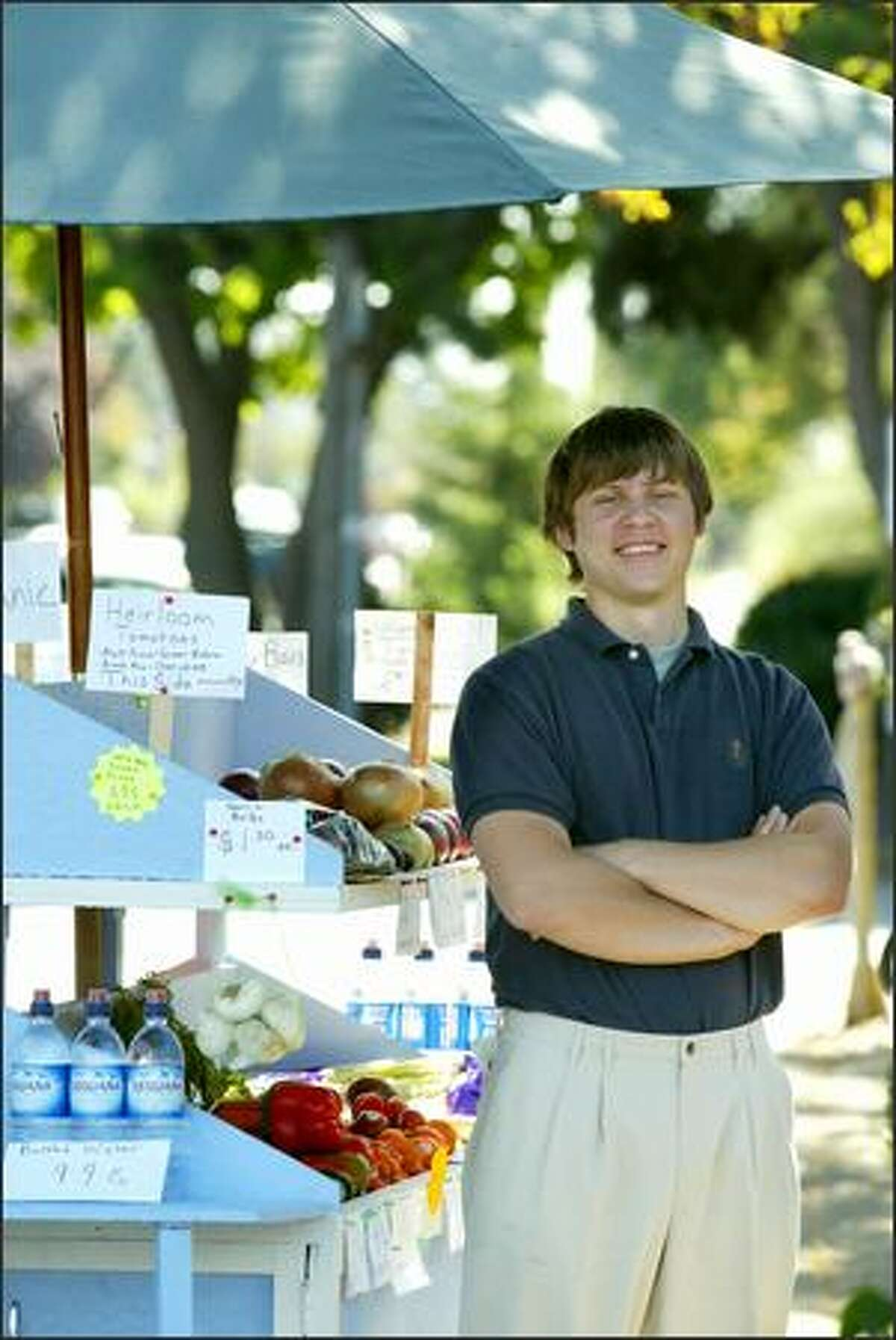 Erik Holsather, a senior business major at the University of Washington, operates a fruit and vegetable stand off Alki Beach in West Seattle.