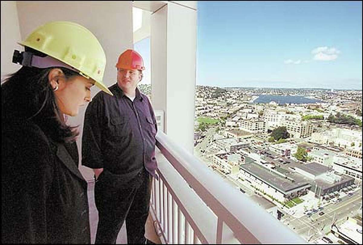 Real estate agent Alycia Rose and client Scott Searle take in the view from the 32nd floor of the new Metropolitan Tower at 1942 Westlake Ave. in downtown Seattle.