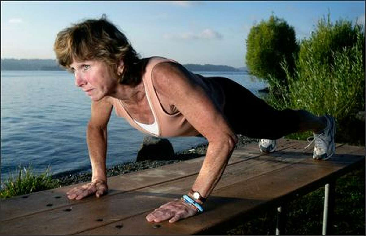 Victoria Scott, a Seattle personal trainer and triathlete, demonstrates a perfect-form push-up, keeping her body in a
