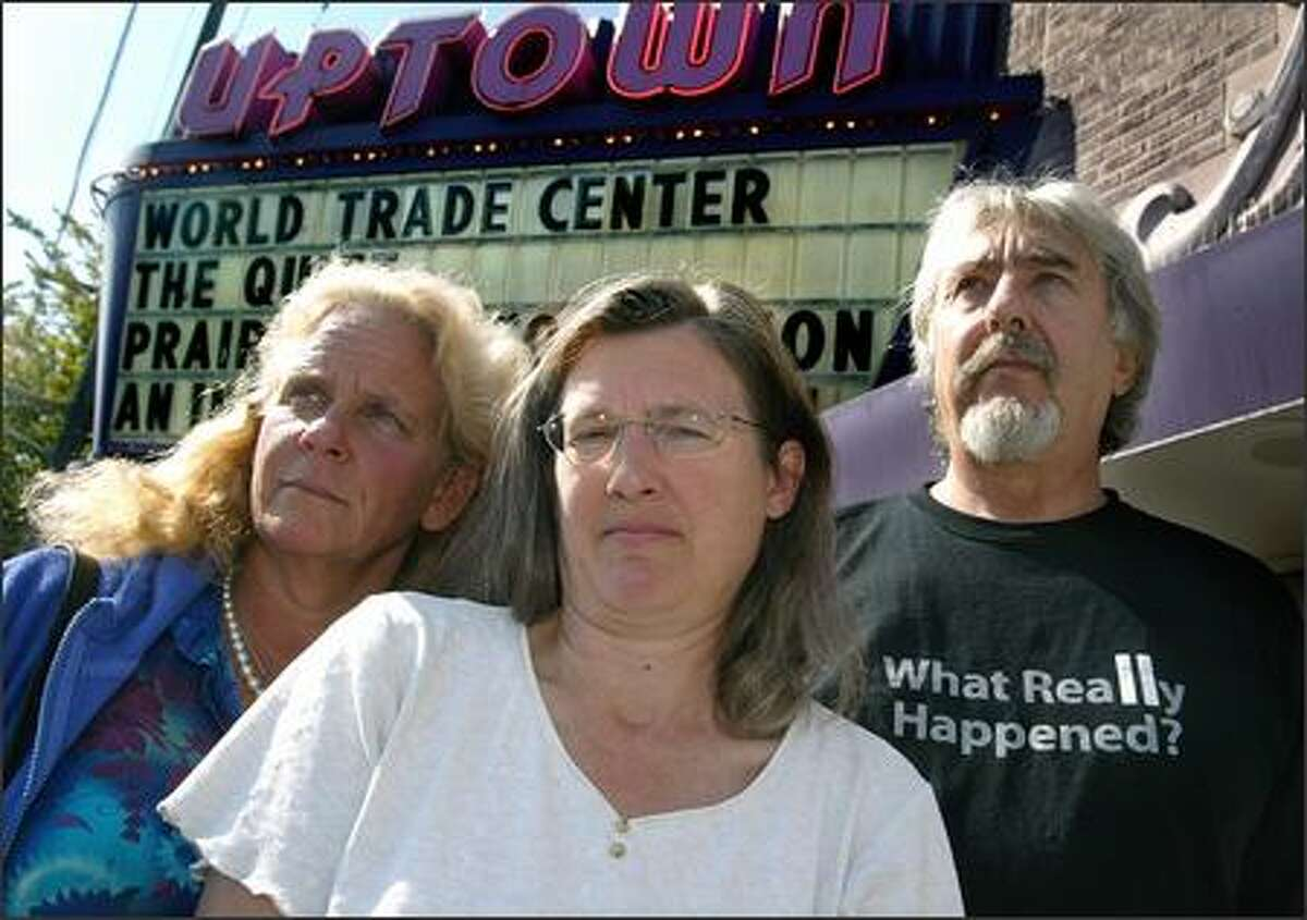 Kim Kerrigan, left, Connie Eichenlaub, center, and Ben Collet are members of the 911 Visibility Project. The Seattle-based group believes the government played a role in the Sept. 11 attacks, and they'll be on the streets today trying to share their message with others.