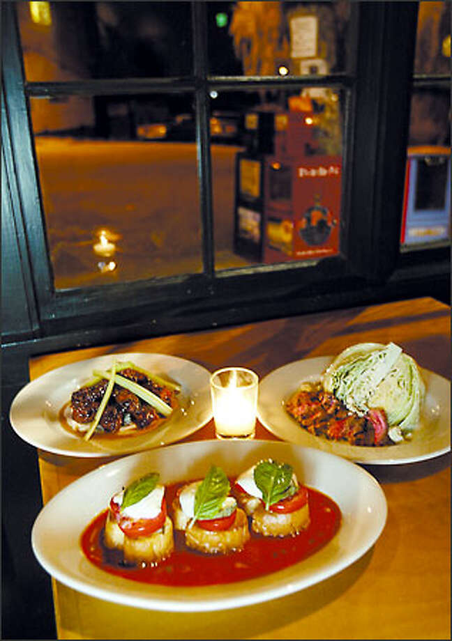 On the menu at Tangletown is, clockwise from top right, Flank Berg, Grilled Caprese Tea Sandwiches in a pool of tomato soup and Sweet and Spicy Chicken Wings. Photo: Scott Eklund, Seattle Post-Intelligencer / Seattle Post-Intelligencer