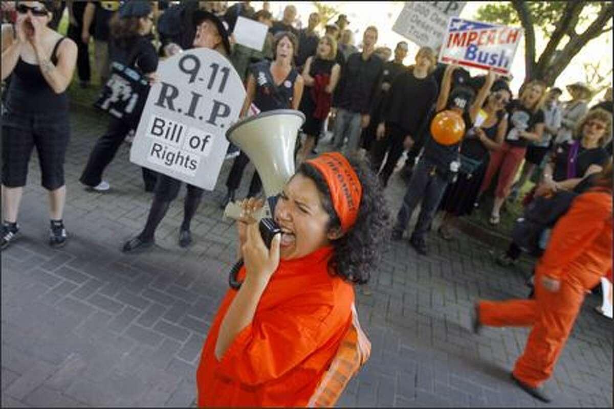 Protester Brianna Herrera chants,