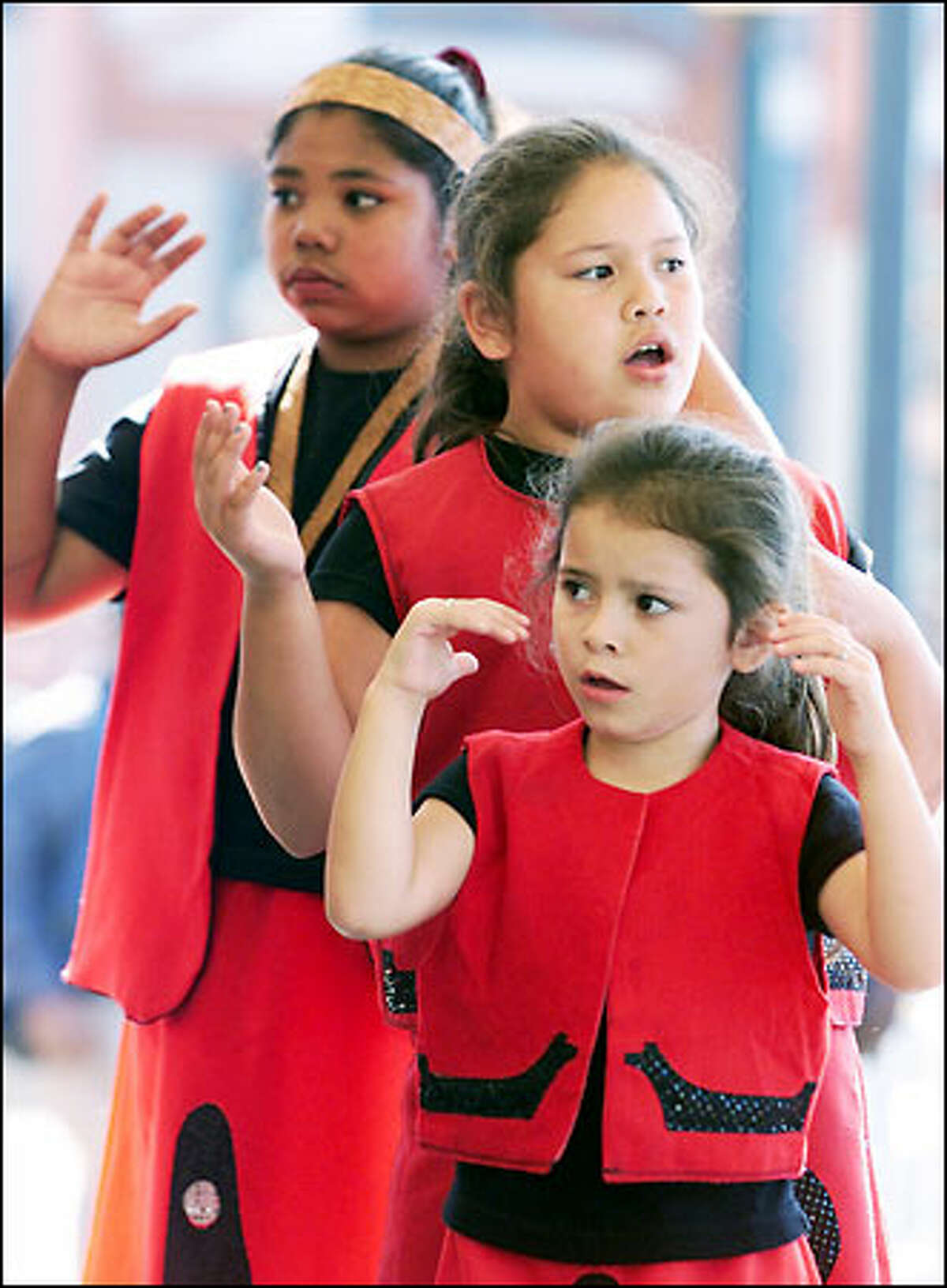 Mekyla Freberg, 5, leads as a group of young Tulalip Canoe Family Dancers performs at the Salmon Homecoming Celebration. leading, perform at the 9th annual Salmon Homecoming Celebration at Waterfront Park yesterday. Salmon Homecoming is dedicated to building bridges between tribal and non-tribal communities, celebrating the significance of salmon in our lives, and working together to ensure Pacific salmon survive. The festival continues through Sunday at Piers 62/63. For more information call (206) 386-4320 or visit www.salmonhomecoming.org. #20010913#Meryl Schenker###Members of the Tulalip Canoe