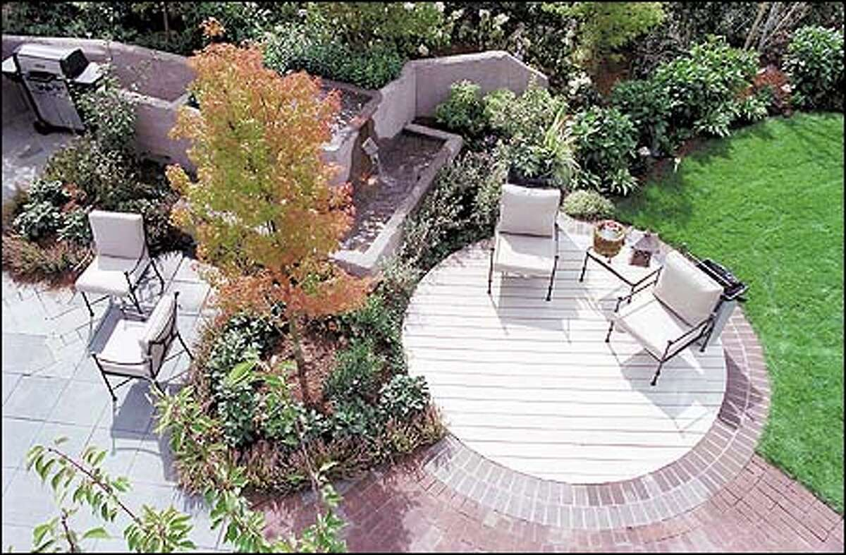 A Japanese maple accents the semi-private back patio of the Sunset Idea House. The patio features paving made from recycled plastic.