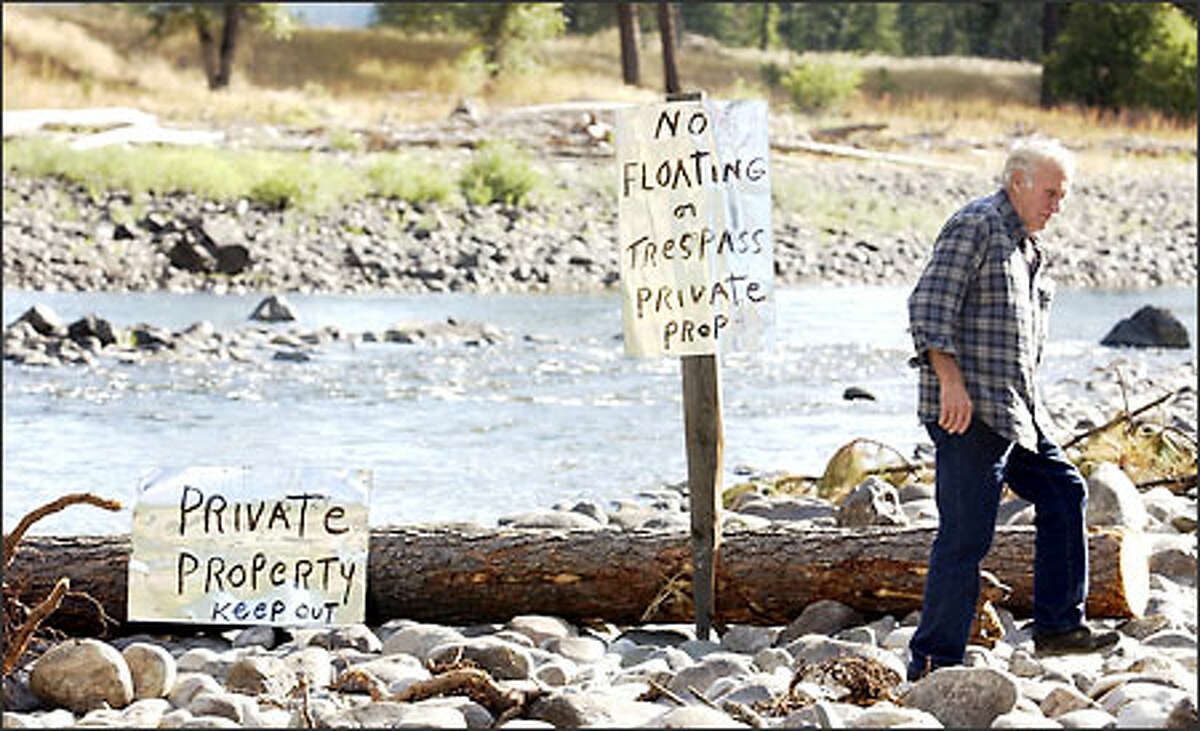 Harold Honeycutt dragged a log across the Kettle River at his Ferry County property to block rafters -- but removed it after threats of jail time.