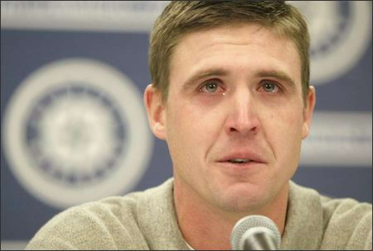 A teary-eyed Dan Wilson, the last Mariners player remaining from their magical 1995 playoff team, announces his retirement at Safeco Field after 12 seasons.