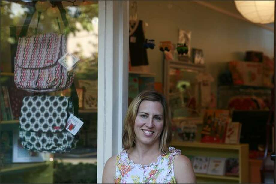 Sarah Isakson's Madison Valley store, Sugarlump, is a consignment store that also sells new clothes and items for small children and pregnant women. Photo: Meryl Schenker, Seattle Post-Intelligencer / Seattle Post-Intelligencer