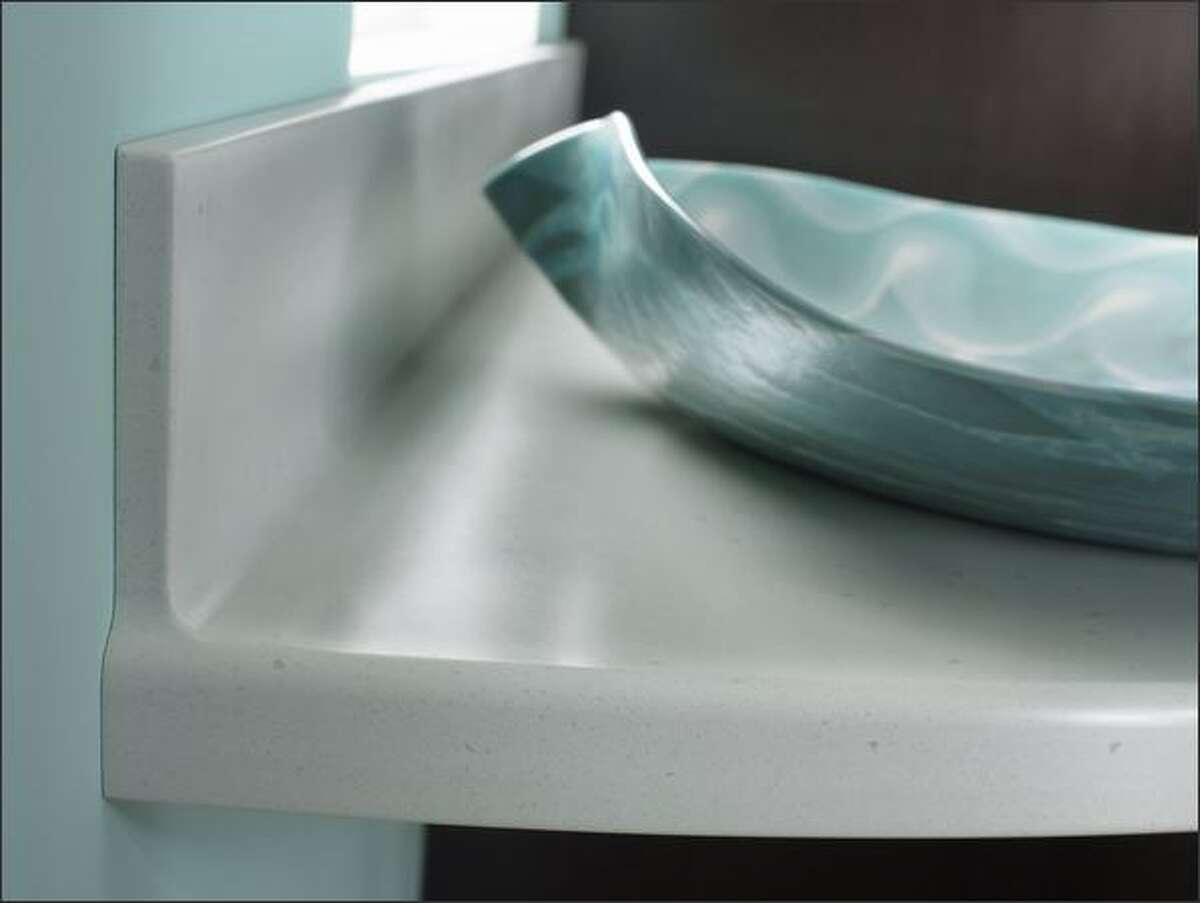 A solid surface countertop of Corian, an acrylic, is nonporous and costs much less than granite.