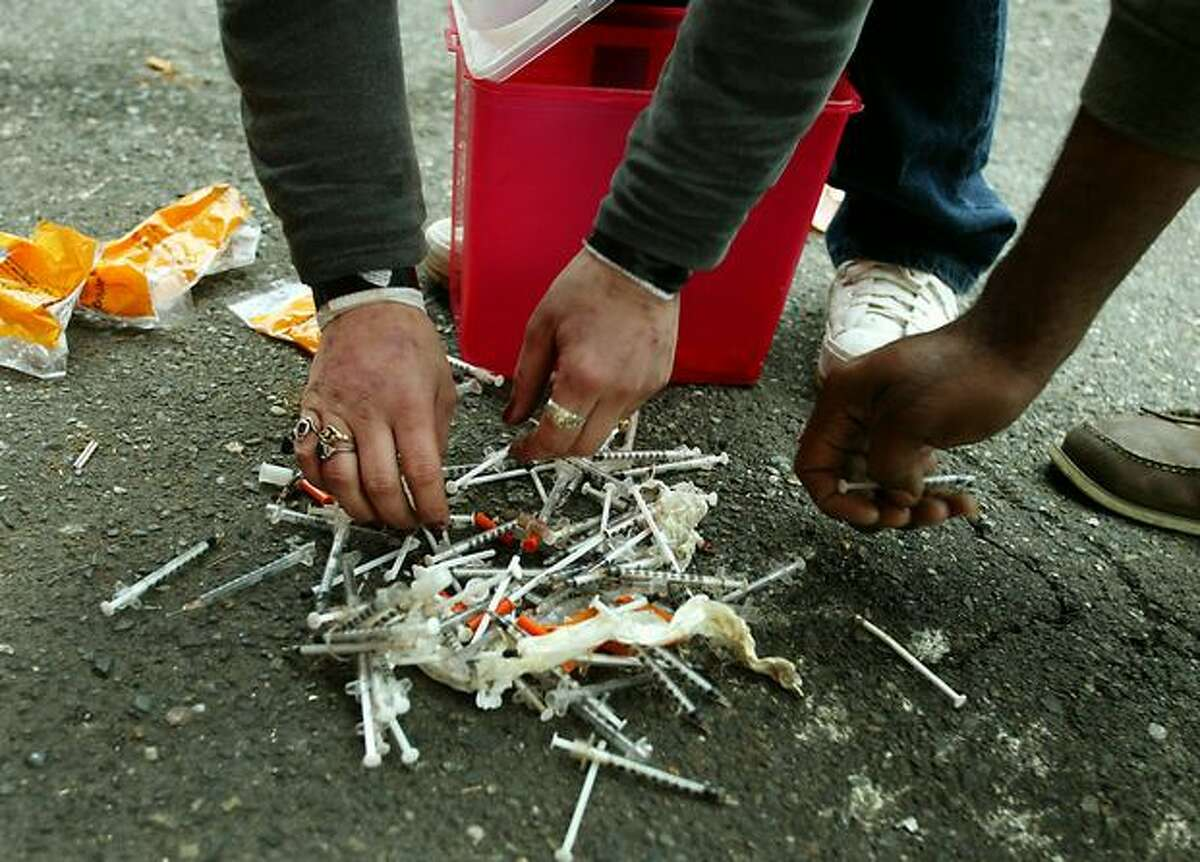 Heroin users dump their needles outside a needle exchange station in the University District in this 2002 file photo.