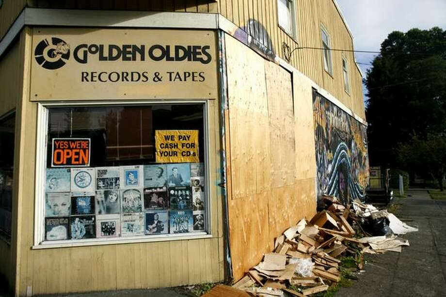 Plywood patches the hole in Golden Oldies Records and Tapes. An SUV drove through the west wall of the Wallingford store the morning of Aug. 8. Photo: Casey McNerthney, Seattlepi.com / seattlepi.com