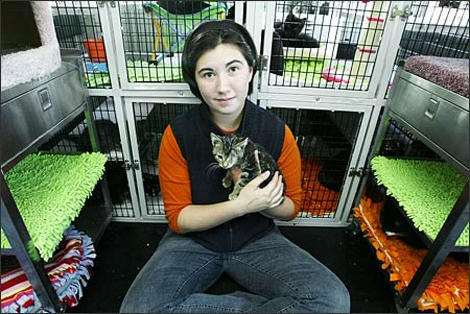 Kristin Pang hopes soon to be on her way to the Gulf Coast with another animal rescue volunteer to save pets affected by Hurricane Katrina. Photo: Gilbert W. Arias, Seattle Post-Intelligencer / Seattle Post-Intelligencer