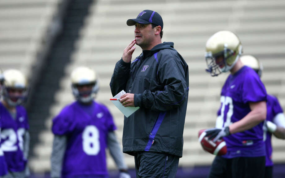 University of Washington Coach Steve Sarkisian works with his team during the first spring practice for the University of Washington football team on Tuesday, March 29, 2011 at Husky Stadium in Seattle. Photo: Joshua Trujillo / Seattlepi.com