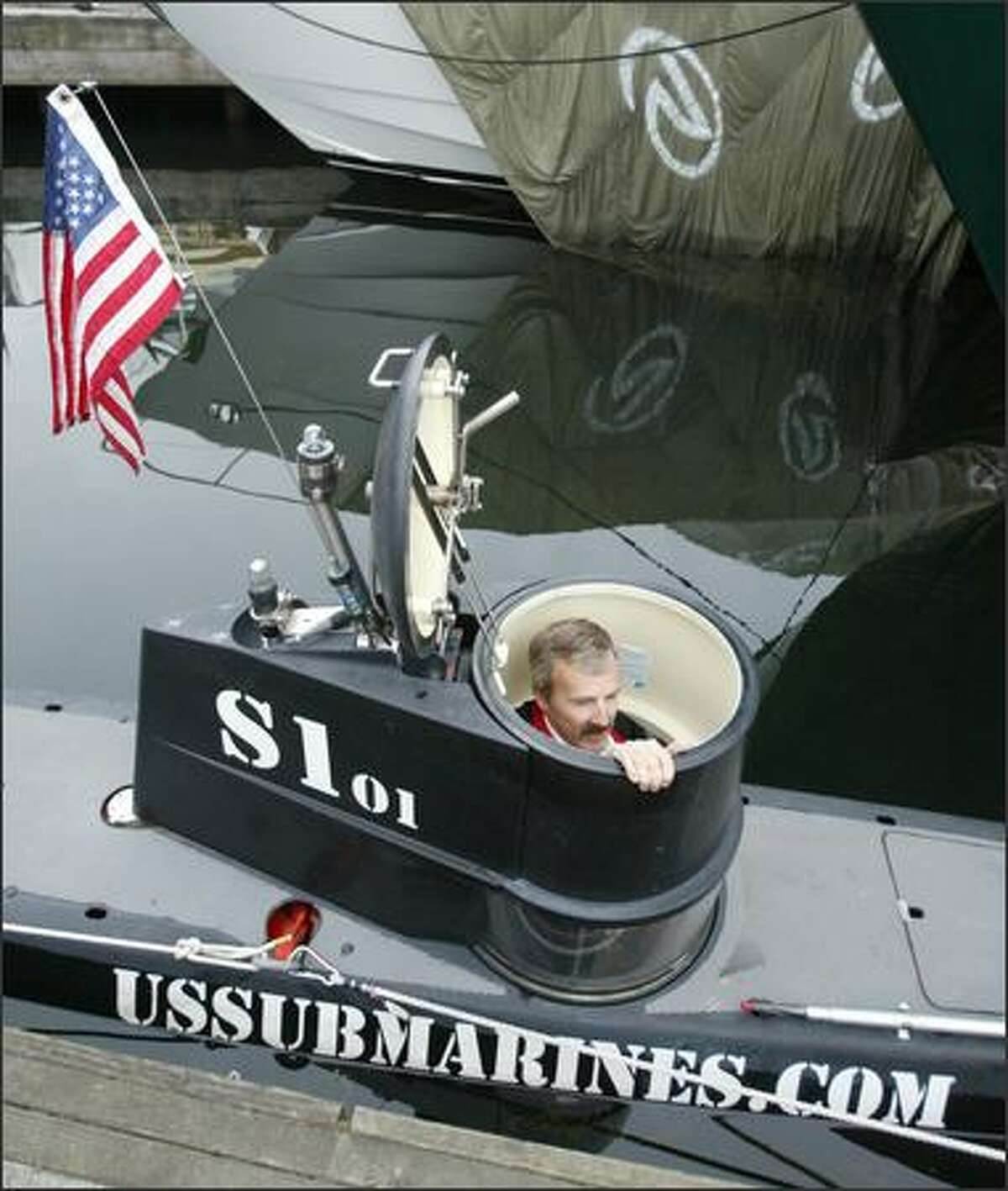 Ellis Adams, vice president of U.S. Submarines, climbs out of one of the vessels.