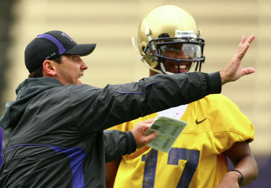 University of Washington Coach Steve Sarkisian works with Keith Price during the first spring practice for the University of Washington football team on Tuesday, March 29, 2011 at Husky Stadium in Seattle. Photo: Joshua Trujillo / Seattlepi.com