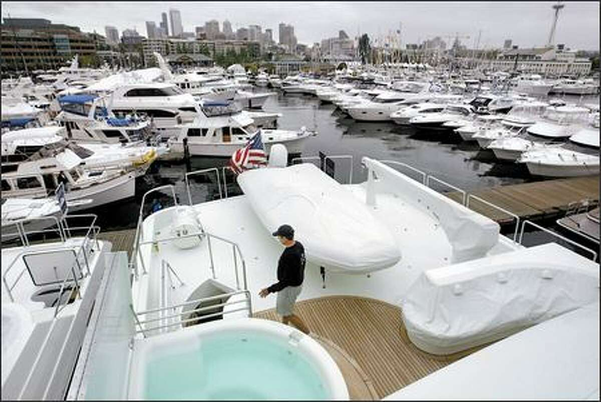 Captain Robert Lowden walks on one of the back decks near the hot tub on the Infinity, a 130-foot, $13.5 million yacht on display at the Boats Afloat Show.