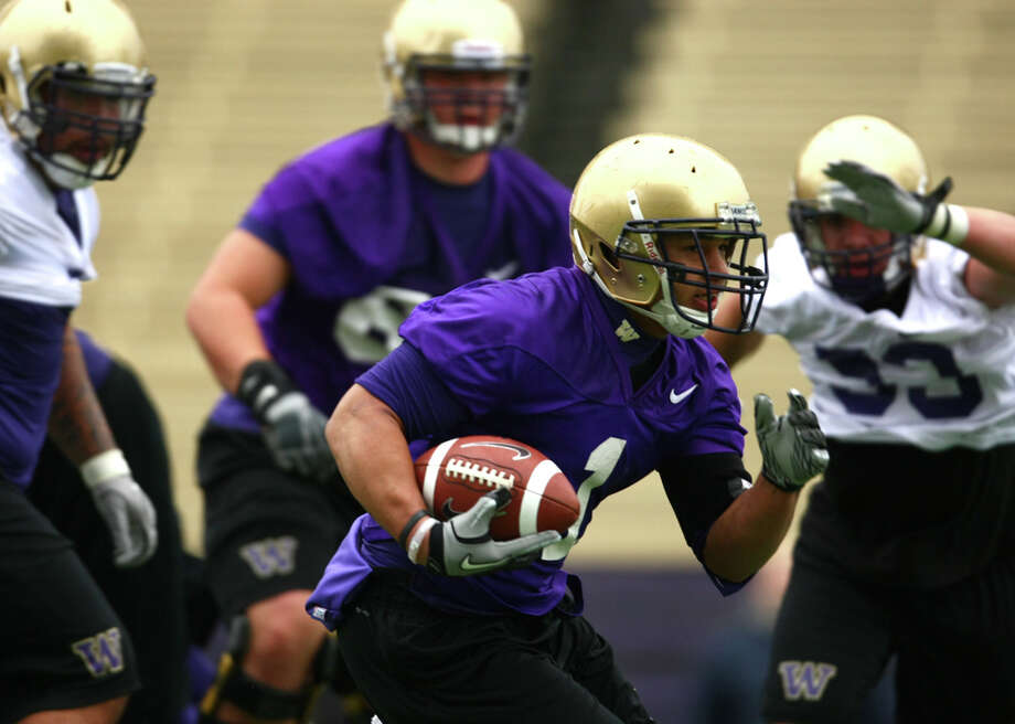 Chris Polk runs the ball during the first spring practice for the University of Washington football team on Tuesday, March 29, 2011 at Husky Stadium in Seattle. Photo: Joshua Trujillo / Seattlepi.com