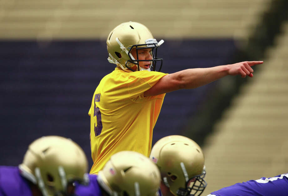 Quarterback Nick Montana calls a play during the first spring practice for the University of Washington football team on Tuesday, March 29, 2011 at Husky Stadium in Seattle. Photo: Joshua Trujillo / Seattlepi.com