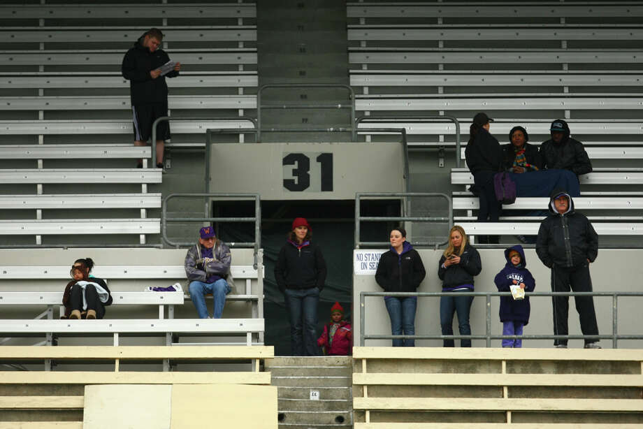 Fans watch the action during the first spring practice for the University of Washington football team on Tuesday, March 29, 2011 at Husky Stadium in Seattle. Photo: Joshua Trujillo / Seattlepi.com