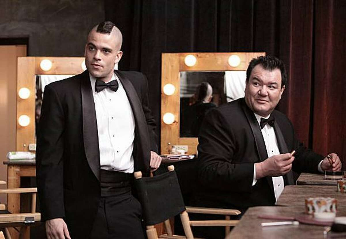 """Puck (Mark Salling, left) and Coach Tanaka (Patrick Gallagher, right) get ready to perform at a PTA function on """"Glee."""""""