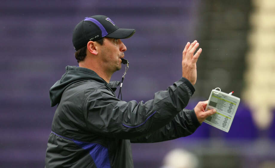 University of Washington Coach Steve Sarkisian works with his team during the first practice for the University of Washington football team on Tuesday, March 29, 2011 at Husky Stadium in Seattle. Photo: Joshua Trujillo / Seattlepi.com