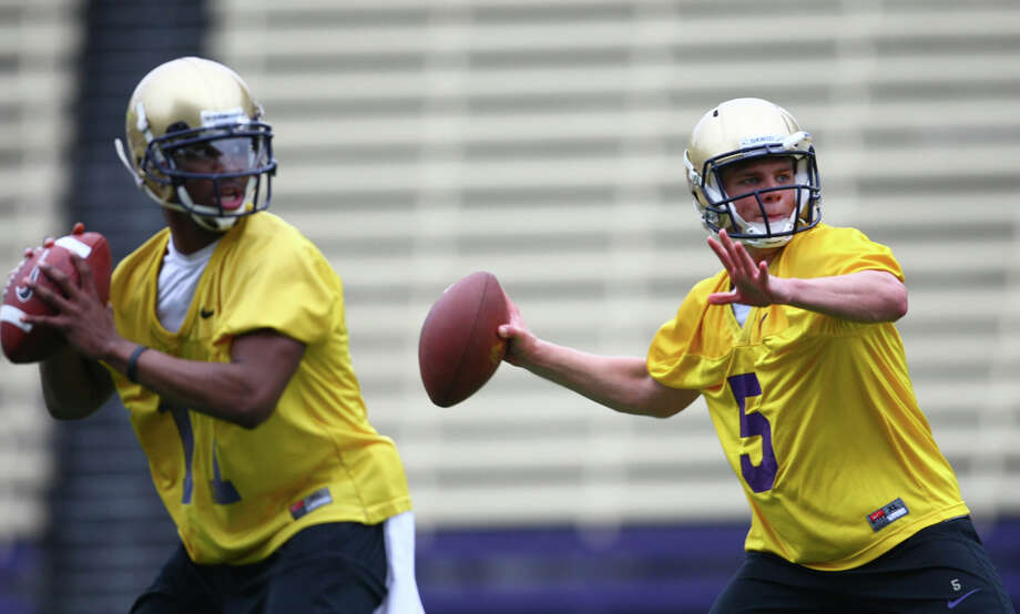 Quarterbacks Keith Price, left, and Nick Montana participate in a drill with the team during the first practice for the University of Washington football team on Tuesday, March 29, 2011 at Husky Stadium in Seattle. Photo: Joshua Trujillo / Seattlepi.com