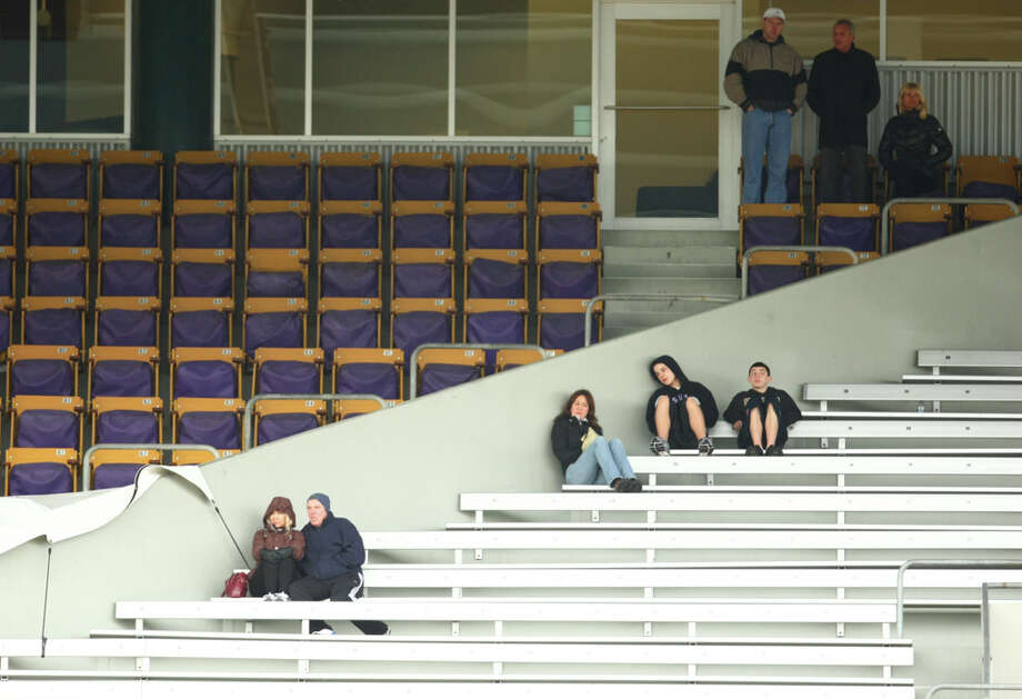 Fans and supporters, including Joe Montana, upper right, dad of quarterback Nick Montana watch during the first spring practice for the University of Washington football team on Tuesday, March 29, 2011 at Husky Stadium in Seattle. Photo: Joshua Trujillo / Seattlepi.com
