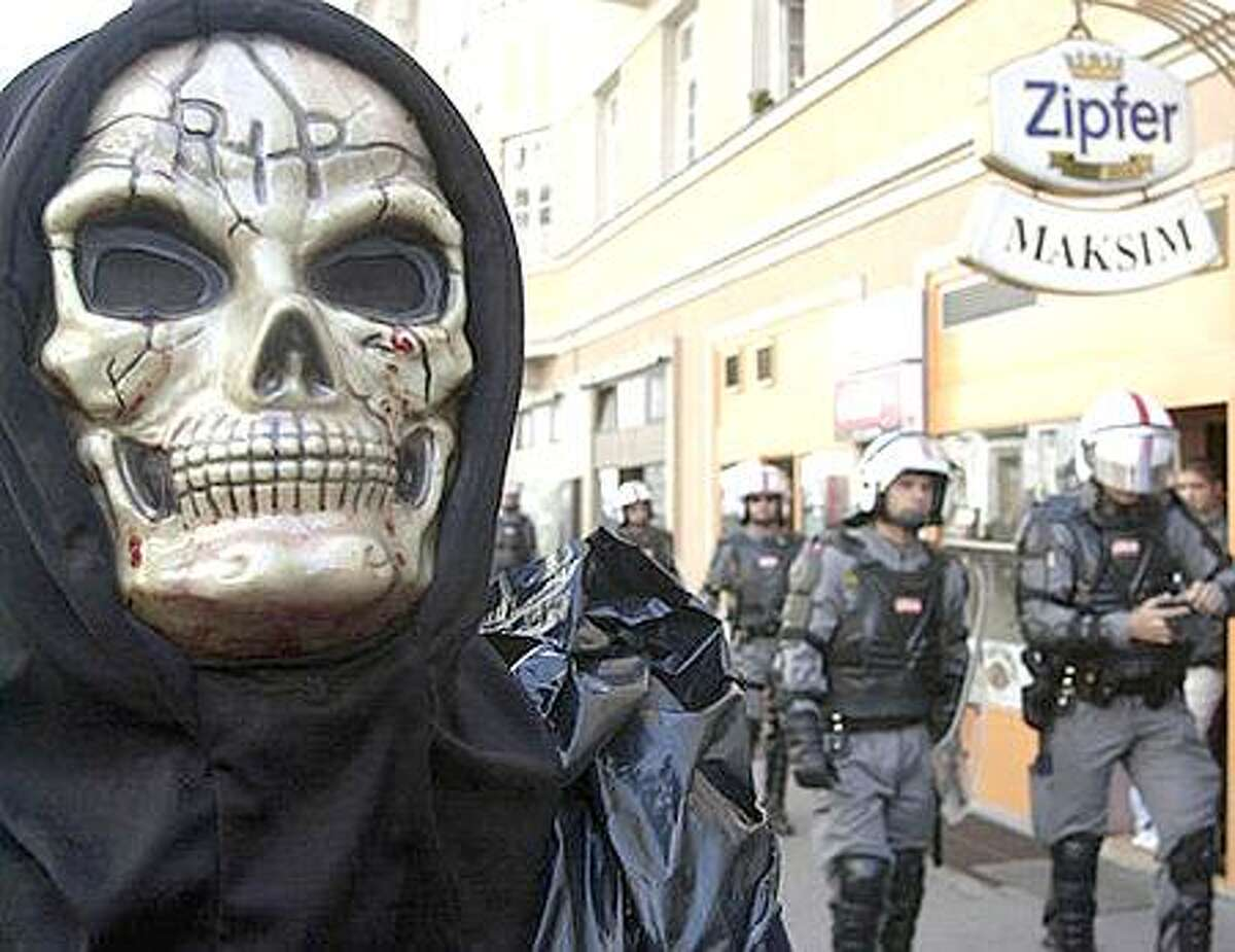 A masked demonstrator is seen on Sunday, Sept. 15, 2002, during an anti-globalization demonstration in Salzburg, Austria, ahead of a European Economic summit starting Monday at the city's congress center. (AP Photo/Darko Bandic)