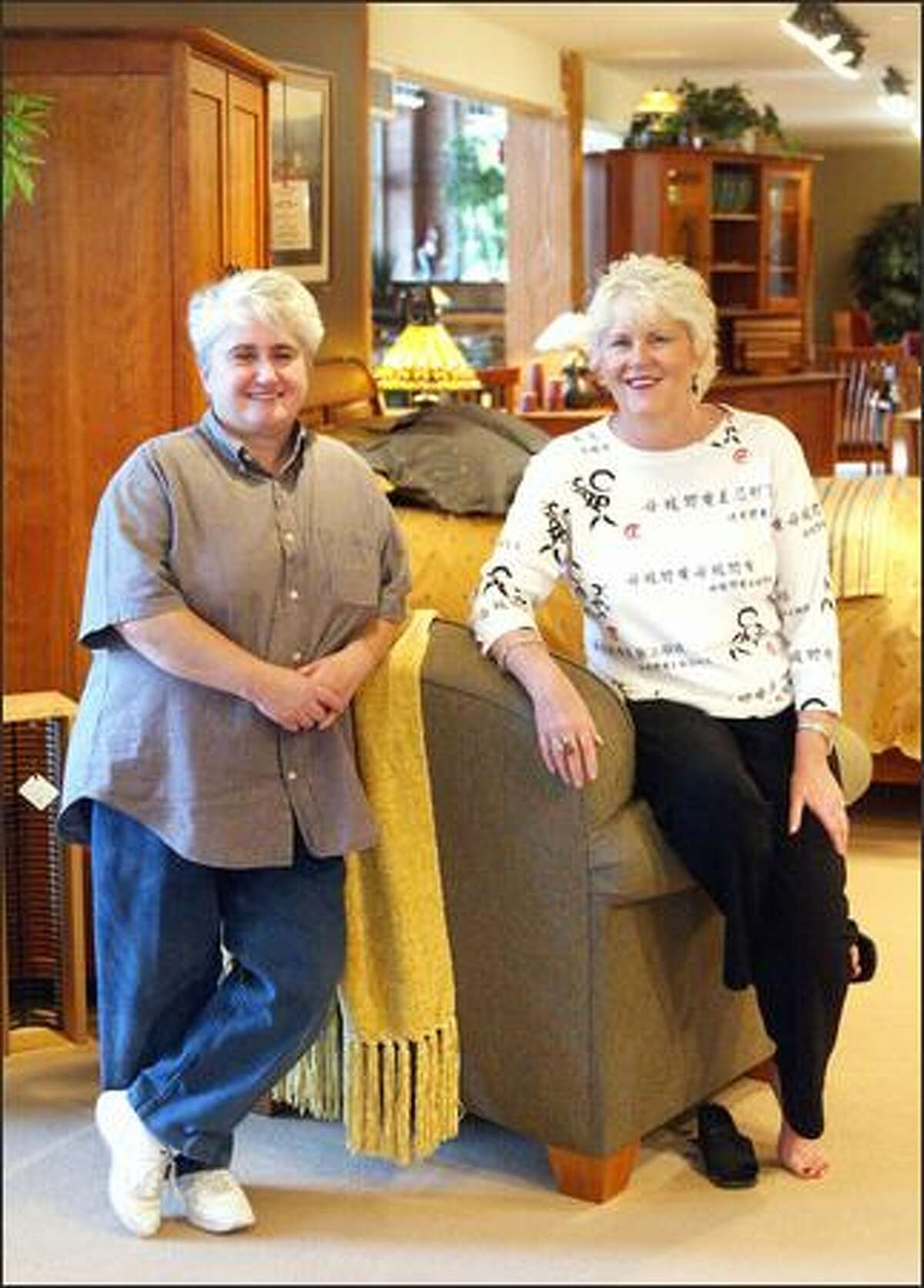 Sheila McKinnon, left, and Theresa Schneider in their store, McKinnon Furniture, on Western Avenue in Seattle.