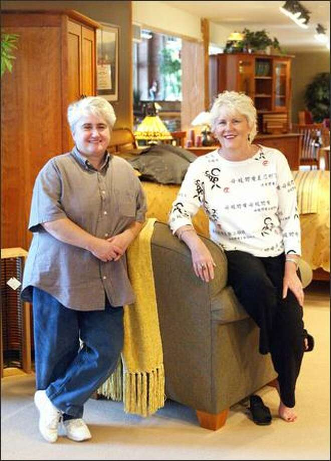 Sheila McKinnon, left, and Theresa Schneider in their store, McKinnon Furniture, on Western Avenue in Seattle. Photo: Phil H. Webber, Seattle Post-Intelligencer / Seattle Post-Intelligencer