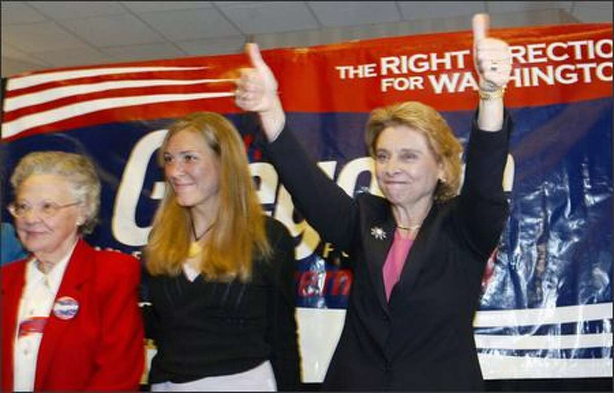 Christine Gregoire gives the thumbs up after winning the Democratic nomination for governor. With her are daughter Michelle and mother-in-law Mary.