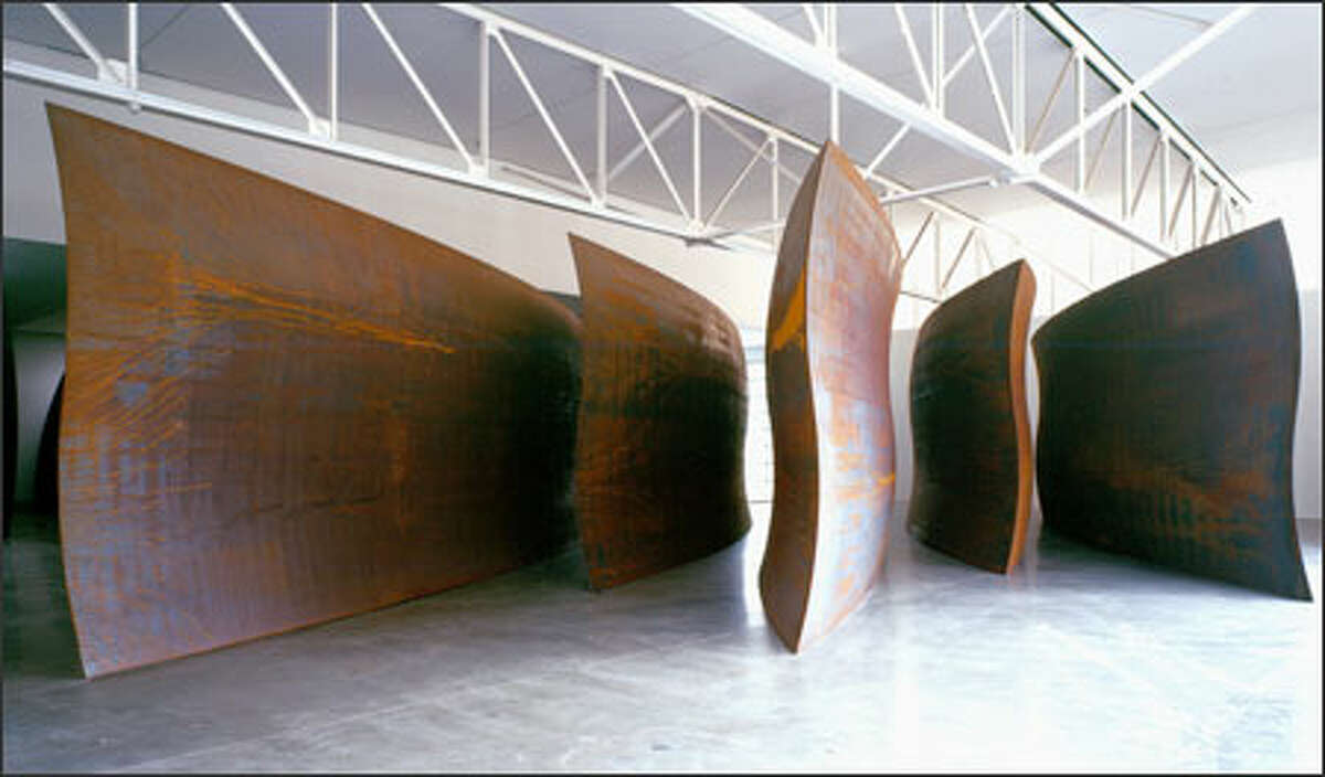"""""""Wake"""" by Richard Serra is the key piece of art in the Seattle Art Museums first round of acquisitions for the Olympic Sculpture Park, opening in 2006. It consists of five pieces of undulating steel, 14 feet high."""