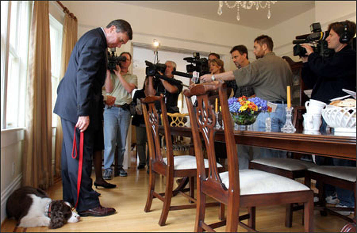 Police Chief Gil Kerlikowske and his English springer spaniel, Belle, meet the media as the chief and his wife, Anna Laszlo, demonstrated their emergency preparations.
