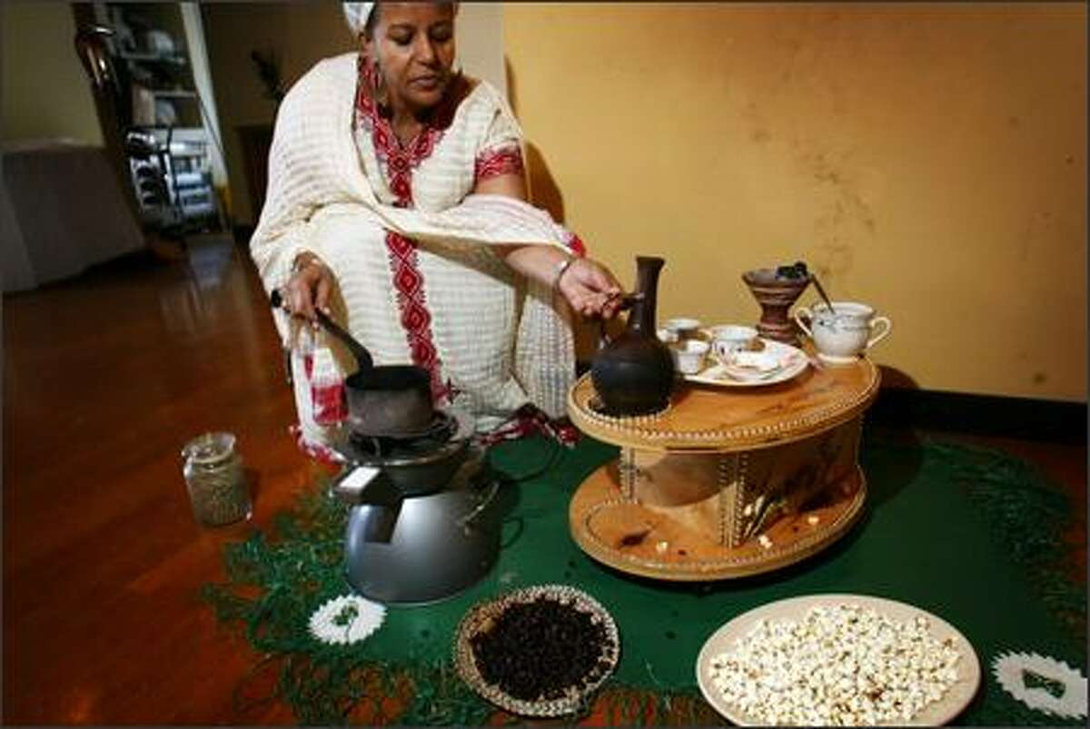 Tseghe Abraham displays the Ethiopian and Eritrean coffees and teas that are served at DeAfric in Columbia Center.