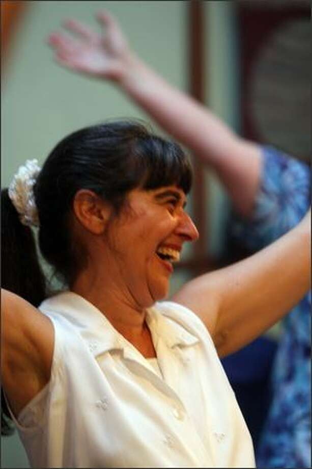 """Laughter brings us more in balance. We become in tune with our natural state, which is basically joyful."" -- Teresa Verde, certified laughter leader. Photo: Mike Kane, Seattle Post-Intelligencer / Seattle Post-Intelligencer"