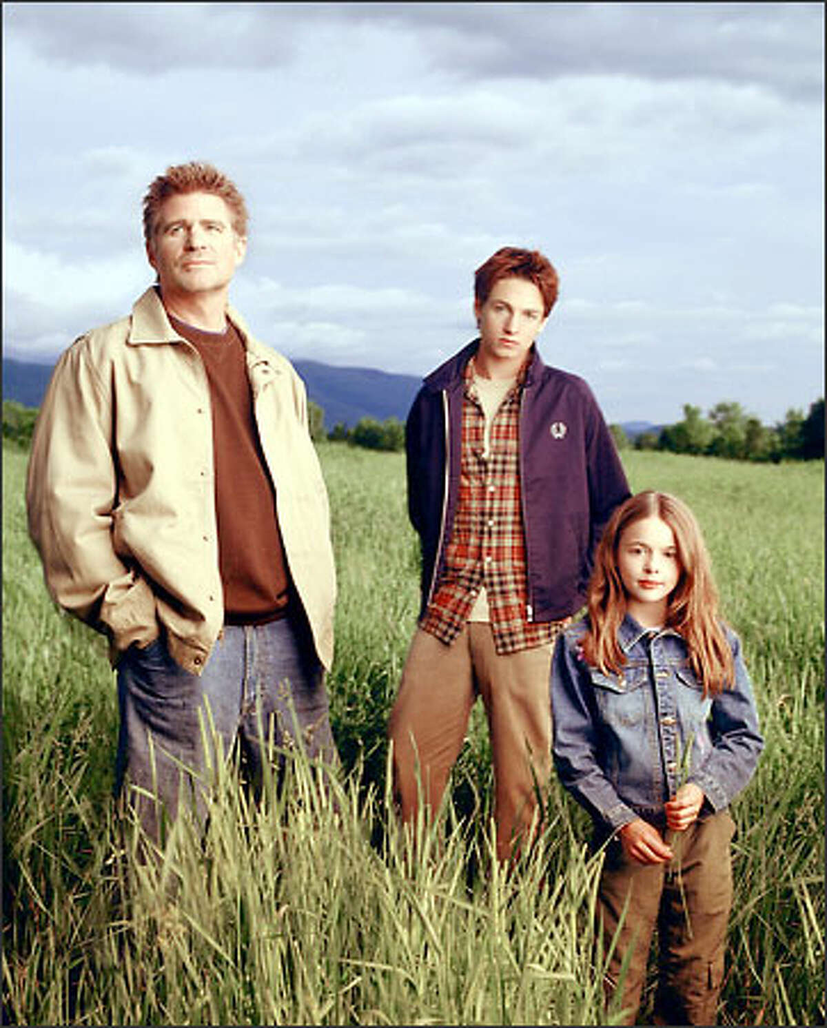 Dr. Andrew Brown (Treat Williams, left) starts a new life with his kids Ephram (Gregory Smith) and Delia (Vivien Cardone).