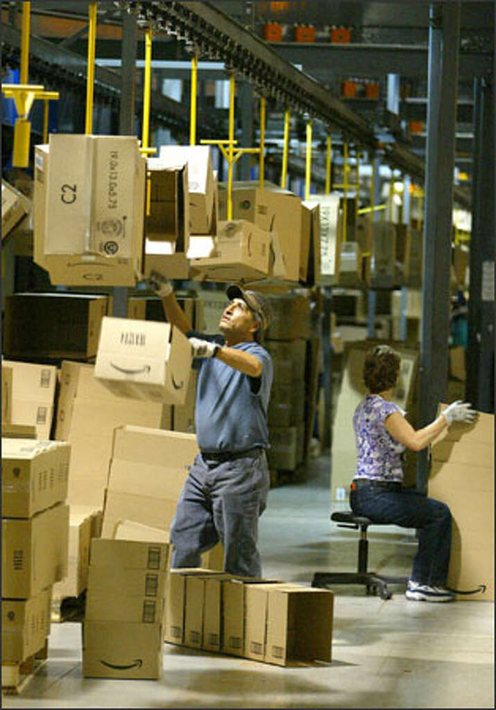 amazon prime air warehouse. mario rosales loads boxes onto a trolley before they are packed with merchandise in amazonu0027s fernley amazon prime air warehouse m