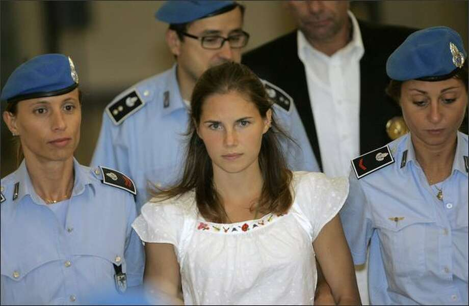 Knox and Sollecito were held in jail without charges for almost a year. Here, Knox arrives in court for a hearing to help decide whether she would face trial for the stabbing death of Kercher. In October 2008, Knox and Sollecito  were formally charged.  Photo: Associated Press / Associated Press