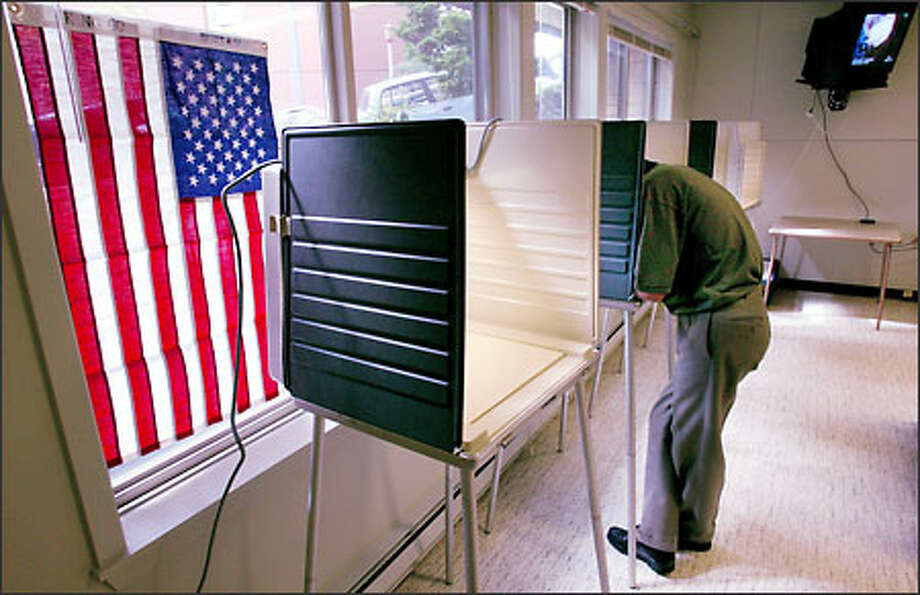 Officials at the International Terrace polling place at Sixth Avenue South and South Main Street reported a relatively good turnout for a primary election. Photo: Paul Joseph Brown, Seattle Post-Intelligencer / Seattle Post-Intelligencer