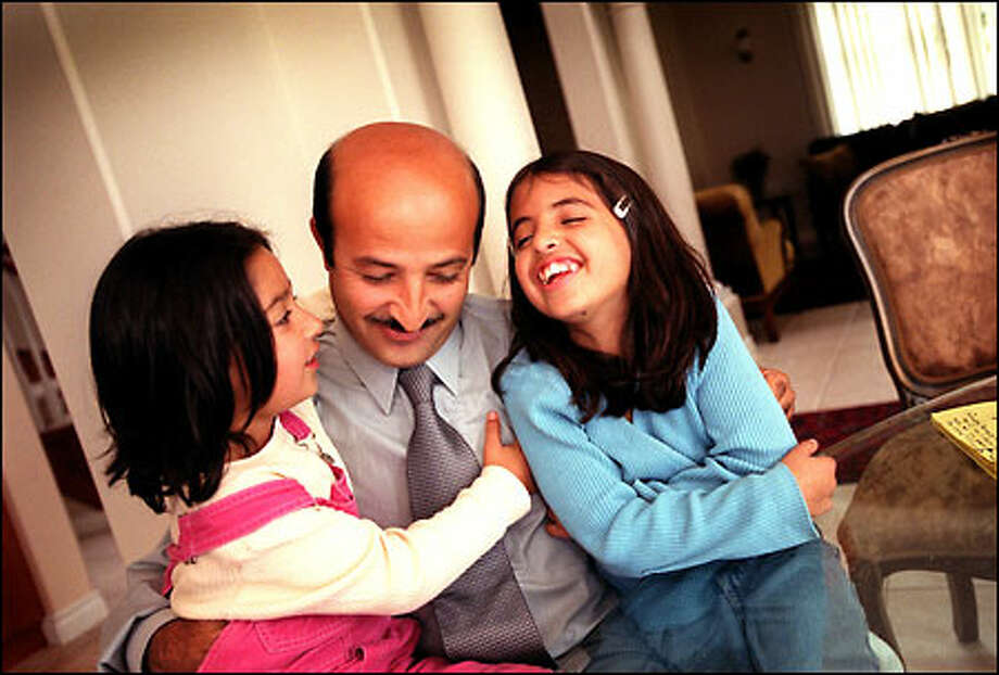 Shafie Ayar, with daughters Misha, 5, and Ilaha, 9, fled Afghanistan 16 years ago and now lives in Federal Way. Photo: Joshua Trujillo, Seattlepi.com / seattlepi.com