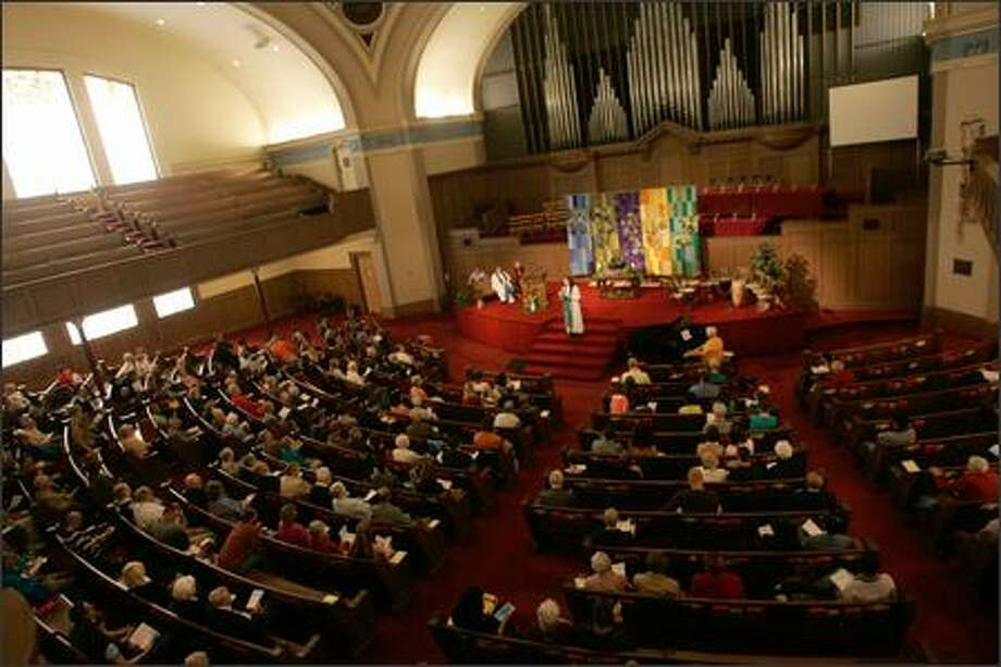 First United Methodist Church members meet for Sunday services. They are expected to vote next month on a plan to save the church. Photo: Mike Kane, Seattle Post-Intelligencer / Seattle Post-Intelligencer