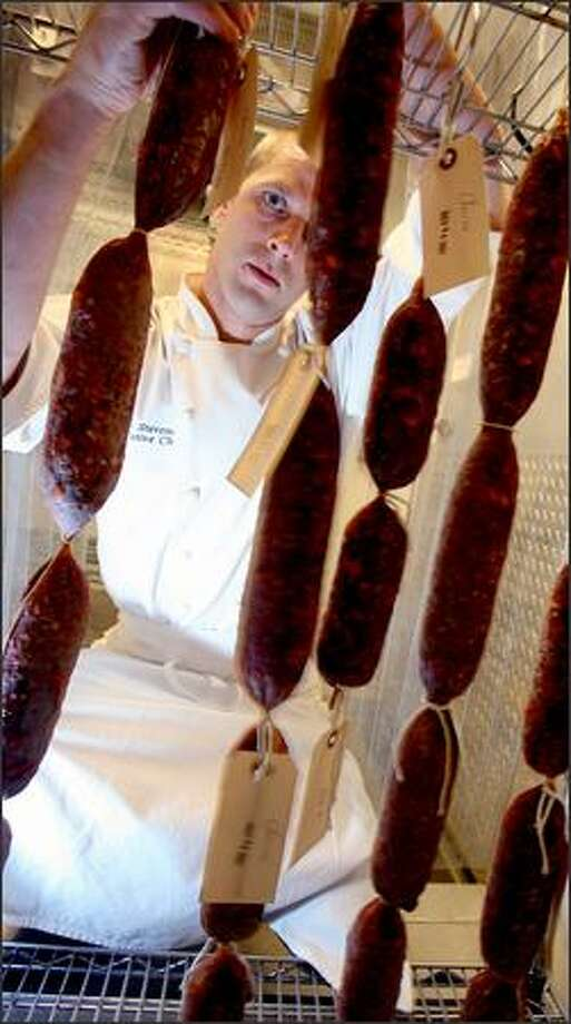Cured meats are a specialty of Earth & Ocean chef Adam Stevenson. He plans to enter his prosciutto in the Salami Challenge Photo: Scott Eklund, Seattle Post-Intelligencer / Seattle Post-Intelligencer