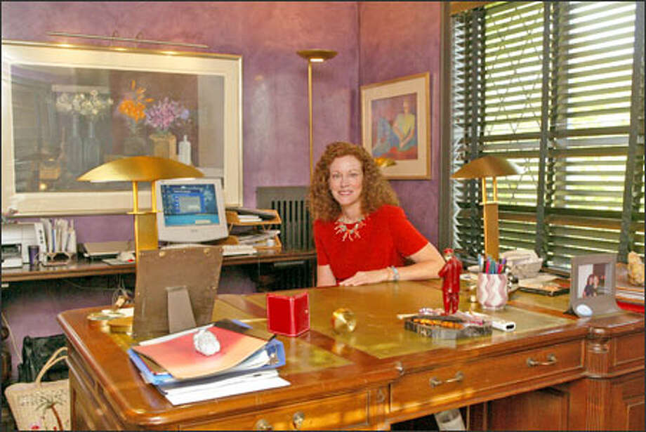 "Mary Snapp, a Microsoft deputy general counsel, in her home office. She says complying with the antitrust decree ""has really become part of the culture."" Photo: Phil H. Webber, Seattle Post-Intelligencer / Seattle Post-Intelligencer"