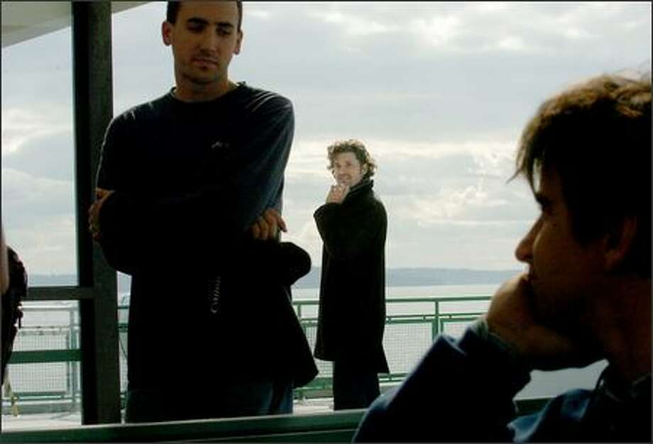 """Patrick Dempsey, center, waits for his cue from director Peter Horton (not pictured) while shooting a scene for """"Grey's Anatomy"""" on the Bainbridge Island ferry. Photo: Steve Shelton, Special To The Seattle Post-Intelligencer / Special to the Seattle Post-Intelligencer"""