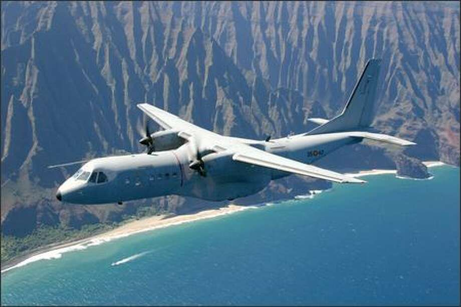 EADS and Raytheon are offering the Army either the C-295, seen here over Hawaii, or its sister, the CN-235. Photo: EADS / EADS